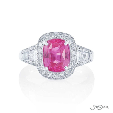 Gorgeous pink sapphire and diamond ring featuring a 3.09 ct. certified cushion-cut pink sapphire with trapezoid and princess-cut diamonds in a center channel in a micro pave setting. Handcrafted in pure platinum. [details] Center Stone(s) SHAPE TYPE WEIGHT Cushion Pink Sapphire 3.09 ct. Notes: AGTA Stone Information SHAPE TYPE WEIGHT Trapezoid Diamond 0.70 ctw. Round Diamond 0.75 ctw. Princess Diamond 0.28 ctw. [enddetails] | JB Star 2477-002 Precious Color Rings