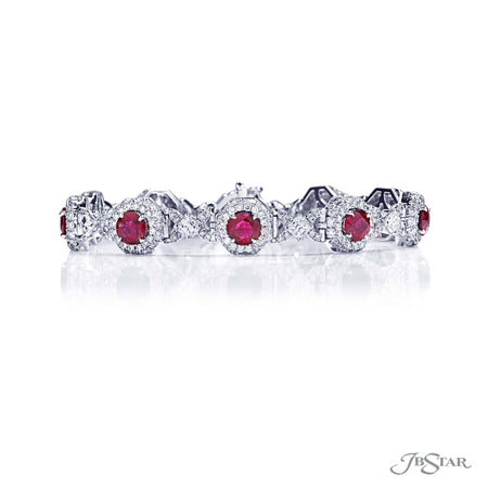 Dazzling ruby and diamond bracelet featuring 10 round rubies encircled by round diamonds and square emerald cut diamonds. Handcrafted in pure platinum. [details] Stone Information SHAPE TYPE WEIGHT Round Round Square Emerald Ruby Diamond Diamond 7.58 ctw. 3.58 ctw. 1.83 ctw. [enddetails] | JB Star 2570-002 Bracelets