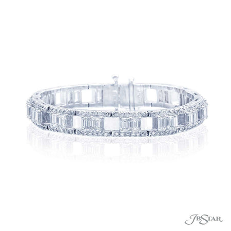 Exceptional platinum bracelet is uniquely designed with perfectly matched emerald-cut diamonds set in a track of round diamonds. Handcrafted in pure platinum. [details] Stone Information SHAPE TYPE WEIGHT Straight Baguette Diamond 9.22 ctw. Round Diamond 3.10 ctw. [enddetails] | JB Star 2571-001 Bracelets