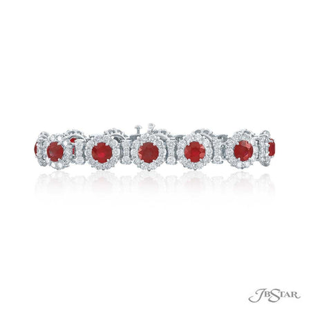 Beautiful ruby and diamond bracelet featuring 12 round rubies encircled by brilliant round diamonds in a shared prong setting. Handcrafted in pure platinum. [details] Stone Information SHAPE TYPE WEIGHT Round Round Ruby Diamond 16.56 ctw. 11.50 ctw. [enddetails] | JB Star 2577-008 Bracelets