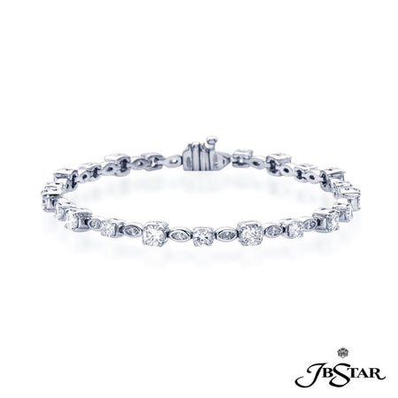 Gorgeous marquise and round diamond bracelet exquisitely handcrafted with 22 perfectly matched marquise and round diamonds. Handcrafted in pure platinum. [details] Stone Information SHAPE TYPE WEIGHT Round Diamond 4.33 ctw. Marquise Diamond 0.68 ctw. [enddetails] | JB Star 2597-001 Bracelets