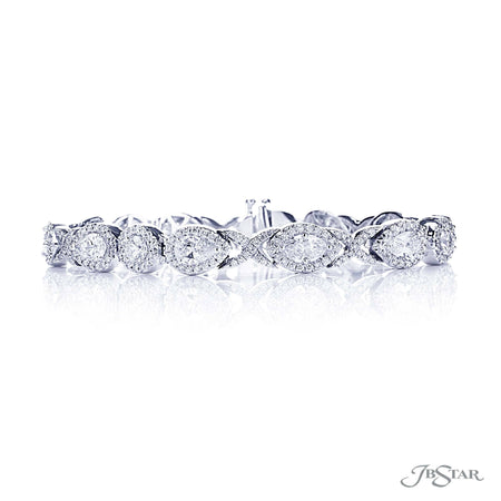 Gorgeous diamond bracelet features marquise, pear-shape and round diamonds exquisitely linked together with pave. Handcrafted in pure platinum. [details] Stone Information SHAPE TYPE WEIGHT Pear Diamond 3.50 ctw. Round Diamond 3.68 ctw. Marquise Diamond 1.62 ctw. [enddetails] | JB Star 2598-002 Bracelets