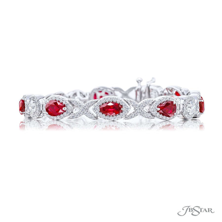 Stunning ruby and diamond bracelet featuring pear shape and marquise rubies and round diamonds surrounded by gorgeous micro pave. Handcrafted in pure platinum. [details] Stone Information SHAPE TYPE WEIGHT Pear Ruby 7.21 ctw. Marquise Ruby 2.13 ctw. Round Diamond 3.71 ctw. [enddetails] | JB Star 2598-003 Bracelets