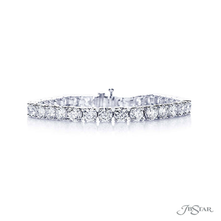 Beautiful diamond tennis bracelet featuring 36 brilliant round diamonds in a prong setting. Handcrafted in pure platinum. [details] Stone Information SHAPE TYPE WEIGHT Round Diamond 13.14 ctw. [enddetails] | JB Star 3607-001 Bracelets