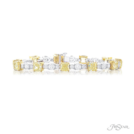 Gorgeous diamond bracelet featuring flawless certified radiant-cut fancy yellow diamonds alternating between brilliant round diamonds. Handcrafted in pure platinum. [details] Center Stone(s) SHAPE TYPE WEIGHT CLARITY Radiant Diamond 11.42 ctw. VS2 Notes: GIA Stone Information SHAPE TYPE WEIGHT Round Diamond 4.28 ctw. [enddetails] | JB Star 3611-001 Bracelets