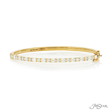 Stunning diamond bangle featuring emerald cut and round diamonds in an alternating setting. Handcrafted in 18KY gold. [details] Stone Information SHAPE TYPE WEIGHT Emerald Diamond 2.21 ctw. Round Diamond 0.99 ctw. [enddetails] | JB Star 3614-002 Bracelets
