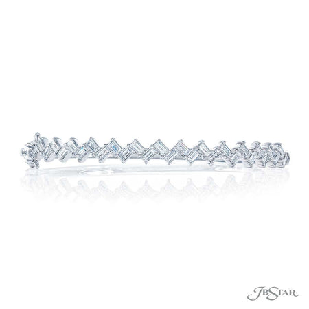 Gorgeous diamond bangle featuring 29 beautifully matched straight baguette diamonds in a shared prong setting. Handcrafted in 18kw white gold. [details] Stone Information SHAPE TYPE WEIGHT Straight Baguette Diamond 2.48 ctw. [enddetails] | JB Star 3626-001 Bracelets