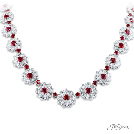 Magnificent Burma ruby and diamond necklace featuring 17.60 ctw of round Burma rubies encircled by pear-shaped diamonds in a beautiful floral design. Handcrafted in pure platinum. [details] Center Stone(s) SHAPE TYPE WEIGHT Round Ruby 17.60 ctw. Stone Information SHAPE TYPE WEIGHT Pear Diamond 45.52 ctw. [enddetails] | JB Star 3673-001 Necklaces