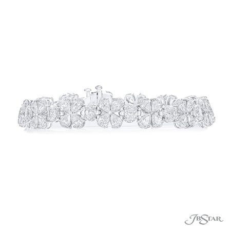 Stunning diamond bracelet featuring pear-shaped and oval diamonds in a beautiful flower design. Handcrafted in pure platinum. [details] Stone Information SHAPE TYPE WEIGHT Pear Diamond 10.78 ctw. Oval Diamond 4.62 ctw. [enddetails] | JB Star 3675-001 Bracelets