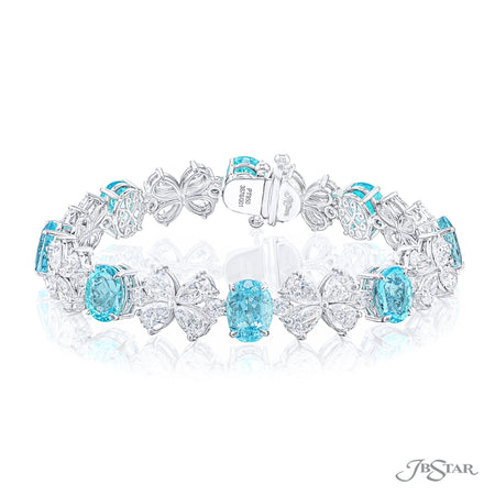 Gorgeous bracelet featuring oval paraibas alternating between pear shaped and round diamonds. Handcrafted in pure platinum. [details] Stone Information SHAPE TYPE WEIGHT Oval Paraiba 16.12 ctw. Pear Diamond 11.10 ctw. Round Diamond 1.18 ctw. [enddetails] | JB Star 3676-001 Bracelets