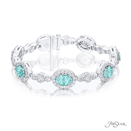 Dazzling paraiba and diamond bracelet featuring 12.04 carats of oval paraibas encircled by round diamonds in a beautiful setting. Handcrafted in pure platinum. [details] Stone Information SHAPE TYPE WEIGHT Oval Paraiba 12.04 ctw. Round Diamond 8.11 ctw. [enddetails] | JB Star 3685-001 Bracelets