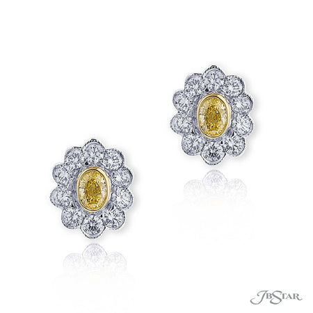 These exquisite earrings feature fancy yellow oval diamonds encircled with perfectly matching round diamonds. Hand set in pure platinum. [details] Center Stone(s) SHAPE TYPE WEIGHT COLOR Oval Diamond 0.73 ctw. Fancy Yellow Stone Information SHAPE TYPE WEIGHT Round Diamond 1.80 ctw. [enddetails] | JB Star 3798-035 Earrings