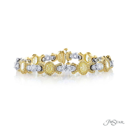 Gorgeous fancy yellow diamond bracelet with 9 oval fancy yellow diamonds in fancy yellow diamond pave and individually set in 18KY prong settings. Accompanied with 9 round diamonds with diamond pave individually set in platinum prong settings. [details] Center Stone(s) SHAPE TYPE WEIGHT COLOR Oval Diamond 5.52 ctw. Fancy Yellow Notes: GIA Stone Information SHAPE TYPE WEIGHT Round Round Diamond Fancy Yellow Diamond 5.15 ctw. 1.05 ctw. [enddetails] | JB Star 3923-002 Bracelets
