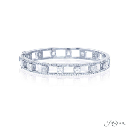 Exceptional diamond bangle is uniquely designed with perfectly matched square emerald diamonds set in a track of round diamonds. Handcrafted in pure platinum. [details] Stone Information SHAPE TYPE WEIGHT Square Emerald Diamond 7.71 ctw. Round Diamond 3.60 ctw. [enddetails] | JB Star 3938-003 Bracelets