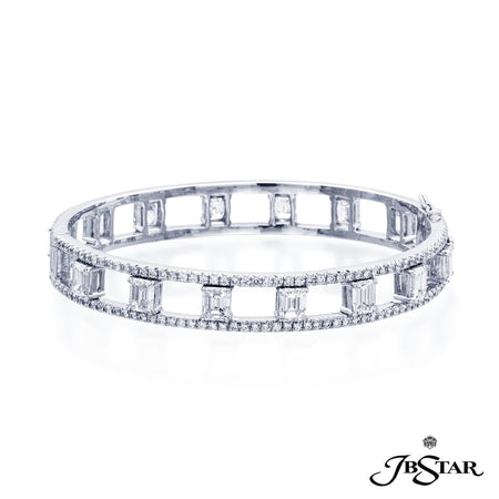 Exquisite diamond bangle uniquely designed with 14 perfectly matched emerald-cut diamonds set in a track of round diamonds. Handcrafted in pure platinum. [details] Stone Information SHAPE TYPE WEIGHT Emerald Diamond 9.30 ctw. Round Diamond 2.97 ctw. [enddetails] | JB Star 3939-001 Bracelets