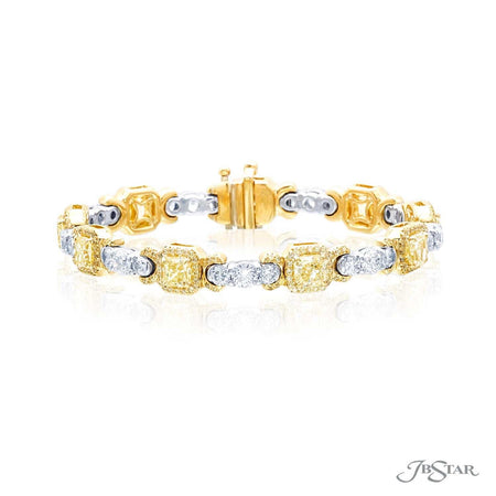 Gorgeous fancy yellow diamond bracelet with 9 radiant-cut fancy yellow diamonds in fancy yellow diamond pave and individually set in 18KY prong settings. Accompanied with 9 round diamonds with diamond pave individually set in platinum prong settings. [details] Center Stone(s) SHAPE TYPE WEIGHT COLOR Radiant Diamond 5.23 ct. Fancy Yellow Notes: GIA Stone Information SHAPE TYPE WEIGHT Round Round Diamond Diamond 4.25 ct. 0.93 ct. [enddetails] | JB Star 3943-003 Bracelets