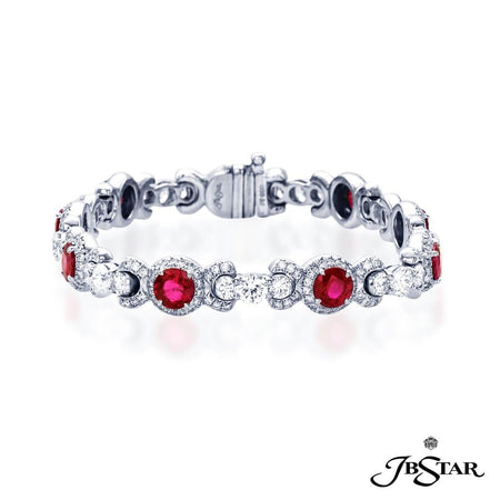 Ruby and diamond bracelet handcrafted with 9 beautifully matched oval rubies, individually set in micro pave, linked together round diamonds. Handcrafted in platinum. [details] Center Stone(s) SHAPE TYPE WEIGHT Round Ruby 5.85 ct. Stone Information SHAPE TYPE WEIGHT Round Diamond 5.53 ct. [enddetails] | JB Star 3993-003 Bracelets