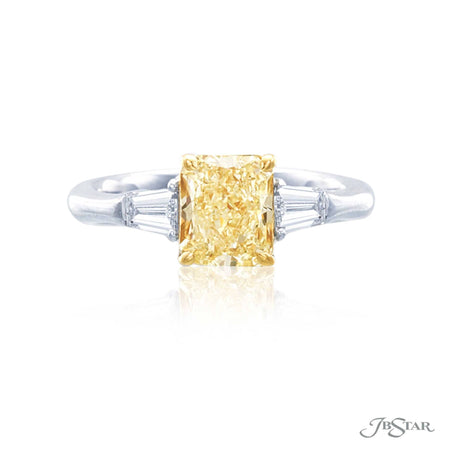 Gorgeous fancy yellow diamond ring featuring a 1.74 ct. GIA certified radiant cut fancy yellow diamond, embraced by tapered baguette diamonds. Handcrafted in platinum and 18KY gold. [details] Center Stone(s) SHAPE TYPE WEIGHT COLOR CLARITY Radiant Cut Diamond 1.74 ct. Fancy Yellow SI2 Notes: GIA Stone Information SHAPE TYPE WEIGHT Tapered Baguette Diamond 0.50 ct. [enddetails] | JB Star 4398-040 Diamond Centers & Engagement