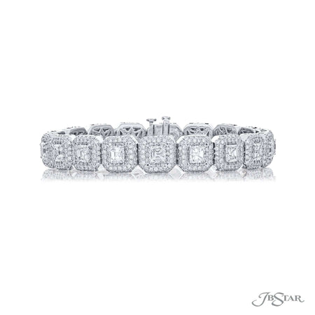 Beautiful diamond bracelet featuring 18 square emerald cut diamonds surrounded by round diamond pave in a prong setting. Handcrafted in pure platinum. [details] Stone Information SHAPE TYPE WEIGHT Square Emerald Diamond 9.88 ctw. Round Diamond 5.75 ctw. [enddetails] | JB Star 4682-001 Bracelets