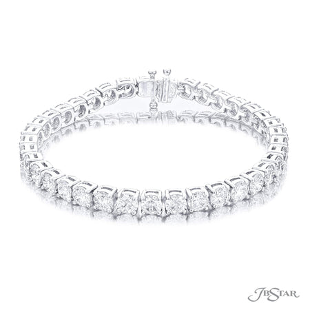Dazzling diamond bracelet featuring 37 perfectly matched round diamonds in a shared prong and platinum setting. Handcrafted in pure platinum. [details] Stone Information SHAPE TYPE WEIGHT Round Diamond 12.86 ctw. [enddetails] | JB Star 4896-006 Bracelets