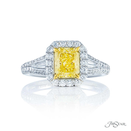 Stunning fancy yellow diamond ring featuring a 1.28 ct. GIA certified radiant-cut fancy yellow diamond center embraced by tapered baguette diamonds, surrounded by micro pave. Handcrafted in pure platinum and 18KY gold. [details] Center Stone(s) SHAPE TYPE WEIGHT CLARITY Radiant Diamond 1.28 ct. VVS2 Stone Information SHAPE TYPE WEIGHT Tapered Baguette Diamond 0.21 ctw. Round Diamond 0.52 ctw. [enddetails] | JB Star 5235-010 Diamond Centers & Engagement