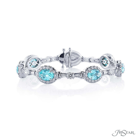 Incredible paraiba and diamond bracelet featuring 7 oval paraibas encircled by round diamonds and designed with tapered baguette and round diamonds. Handcrafted in pure platinum. [details] Center Stone(s) SHAPE TYPE WEIGHT Oval Paraiba 8.56 ct. Stone Information SHAPE TYPE WEIGHT Round Tapered Baguette Diamond Diamond 3.70 ctw. 1.45 ctw. [enddetails] | JB Star 5236-001 Bracelets