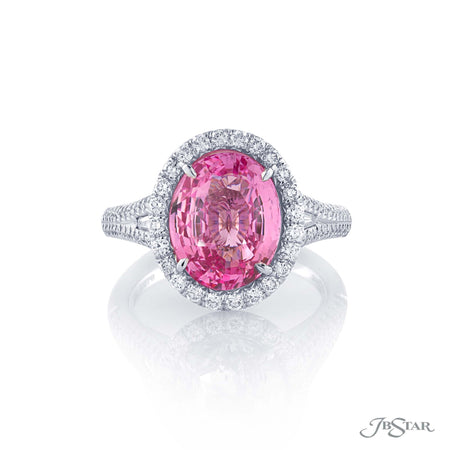 Dazzling pink sapphire and diamond ring featuring an incredible 5.52 ct. GIA certified oval pink sapphire enhanced by tapered baguettes and set in a micro pave halo setting. Handcrafted in pure platinum. [details] Center Stone(s) SHAPE TYPE WEIGHT Oval Pink Sapphire 5.52 ct. Notes: GIA Stone Information SHAPE TYPE WEIGHT Round Tapered Baguette Diamond Diamond 0.70 ctw. 0.25 ctw. [enddetails] | JB Star 5250-002 Precious Color Rings