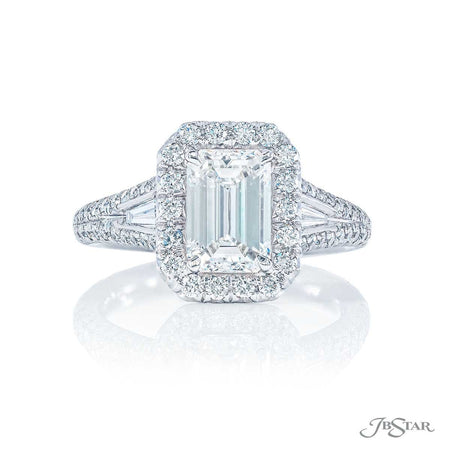 Dazzling diamond engagement ring featuring a 1.27 ct. GIA certified emerald-cut diamond embraced by two tapered baguette diamonds in a micro pave setting. Handcrafted in pure platinum. [details] Center Stone(s) SHAPE TYPE WEIGHT COLOR CLARITY Emerald Diamond 1.27 ct. H VS1 Stone Information SHAPE TYPE WEIGHT Tapered Baguette Round Diamond Diamond 0.18 ctw. 0.60 ctw. [enddetails] | JB Star 5250-059 Diamond Centers & Engagement