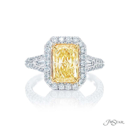 Stunning fancy yellow diamond ring featuring a 2.53 ct. GIA certified radiant-cut fancy yellow diamond center embraced by tapered baguette diamonds in a micro pave setting. Handcrafted in 18KY gold and pure platinum. [details] Center Stone(s) SHAPE TYPE WEIGHT COLOR CLARITY Radiant Diamond 2.53 ct. Fancy Yellow VS2 Notes: GIA Stone Information SHAPE TYPE WEIGHT Round Tapered Baguette Diamond Diamond 0.70 ctw. 0.36 ctw. [enddetails] | JB Star 5250-062 Diamond Centers & Engagement