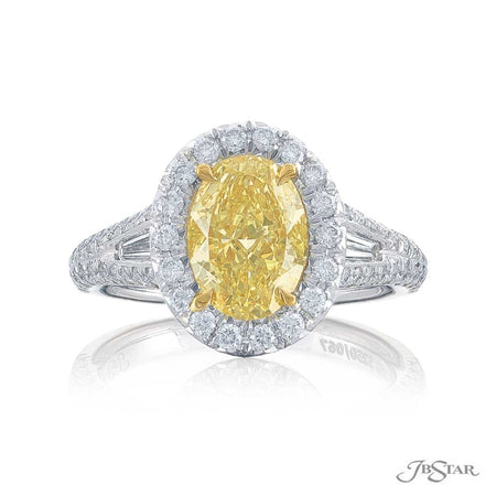 Gorgeous fancy yellow diamond ring featuring a stunning 1.24 ct. GIA certified oval fancy diamond center in a micro pave setting with tapered baguettes. Handcrafted in pure platinum and 18KY gold. [details] Center Stone(s) SHAPE TYPE WEIGHT CLARITY Oval Fancy Yellow Diamond 1.24 ct. SI1 Notes: GIA Stone Information SHAPE TYPE WEIGHT Round Tapered Baguette Round Diamond Diamond Fancy Yellow Diamond 0.57 ctw. 0.23 ctw. 0.08 ctw. [enddetails] | JB Star 5250-067 Diamond Centers & Engagement