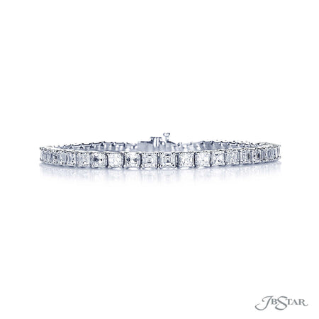 Stunning diamond bracelet featuring 47 perfectly matched square emerald-cut diamonds in a shared prong setting. Handcrafted in pure platinum. [details] Stone Information SHAPE TYPE WEIGHT Square Emerald Diamond 8.32 ctw. [enddetails] | JB Star 5509-001 Bracelets