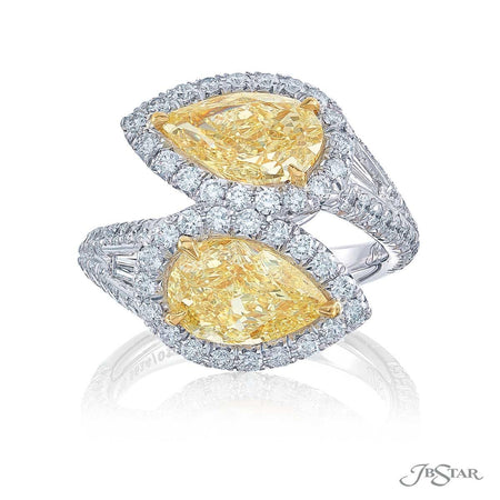 The stunning forever Twogether two stone ring featuring 2 GIA certified fancy yellow pear shaped diamonds embracing each other in a micro pave setting. Handcrafted in pure platinum. [details] Center Stone(s) SHAPE TYPE WEIGHT COLOR CLARITY Pear Diamond 3.12 ctw. Fancy Yellow IF/VVS2 GIA Stone Information SHAPE TYPE WEIGHT Tapered Baguette Diamond 0.30 ctw. Round Diamond 1.16 ctw. [enddetails] | JB Star 5614-017 Diamond Centers & Engagement