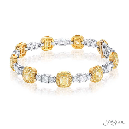 Dazzling fancy yellow diamond bracelet featuring fancy yellow radiant cut diamonds surrounded by fancy yellow micro pave and linked together by radiant cut diamonds. Handcrafted in pure platinum and 18KY gold. [details] Stone Information SHAPE TYPE WEIGHT Radiant Fancy Yellow Diamond 6.92 ctw. Radiant Diamond 3.18 ctw. Round Diamond 2.39 ctw. Round Fancy Yellow Diamond 1.51 ctw. [enddetails] | JB Star 5661-002 Bracelets