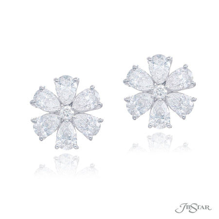 Gorgeous diamond stud earrings in a beautiful flower design featuring a round and pear shaped diamonds. Handcrafted in pure platinum. [details] Stone Information SHAPE TYPE WEIGHT Pear Diamond 3.66 ctw. Round Diamond 0.14 ctw. [enddetails] | JB Star 5727-002 Earrings