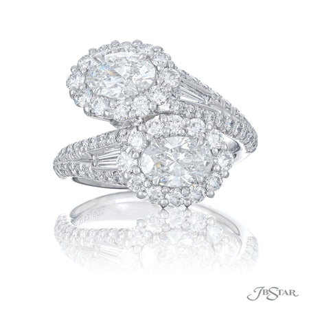 Magnificent twogether two stone ring featuring a 2 certified oval diamonds embracing each other with encircling round diamonds and tapered baguette diamonds. Handcrafted in pure platinum. [details] Center Stone(s) SHAPE TYPE WEIGHT COLOR CLARITY Oval Diamond 1.43 ctw. E-F VS1/VS2 GIA Stone Information SHAPE TYPE WEIGHT Tapered Baguette Diamond 0.27 ctw. Round Diamond 1.28 ctw. [enddetails] | JB Star 5743-001 Diamond Centers & Engagement