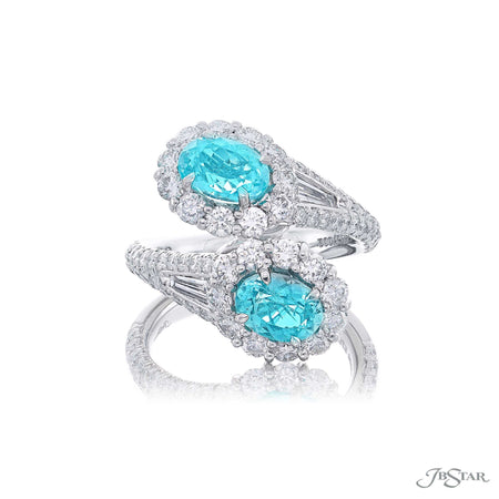 Magnificent paraiba and diamond two stone ring featuring two oval paraibas in our Twogether design edged in diamond pave. Handcrafted in pure platinum. [details] Center Stone(s) SHAPE TYPE WEIGHT Oval Paraiba 1.99 ctw. Stone Information SHAPE TYPE WEIGHT Round Diamond 1.72 ctw. Tapered Baguette Diamond 0.23 ctw. [enddetails] | JB Star 5752-002 Precious Color Rings