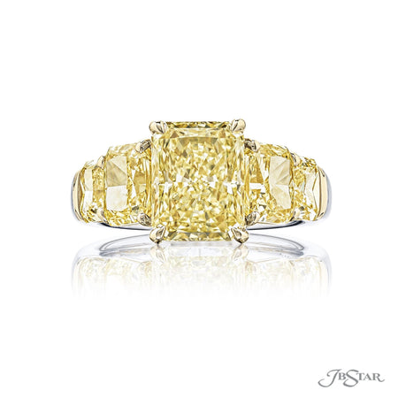 Spectacular fancy yellow diamond ring featuring a 3.05 ct. GIA certified radiant-cut fancy yellow diamond center embraced by 2 certified radiant fancy yellow diamonds in a prong setting. Handcrafted in platinum and 18KY gold. [details] Center Stone(s) SHAPE TYPE WEIGHT CLARITY Radiant Diamond 3.05 ct. VS2 Notes: GIA Stone Information SHAPE TYPE WEIGHT Radiant Diamond 3.89 ctw. [enddetails] | JB Star 5817-001 Diamond Centers & Engagement