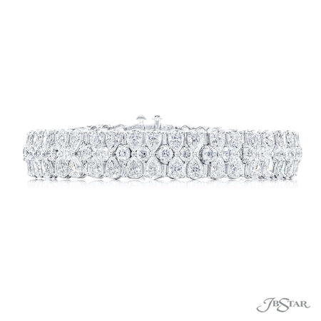 Dazzling diamond bracelet featuring pear-shaped and round diamonds in a beautiful floral like design. Handcrafted in a shared prong platinum setting. [details] Stone Information SHAPE TYPE WEIGHT Pear Round Diamond Diamond 17.32 ctw. 4.48 ctw. [enddetails] | JB Star 5818-001 Bracelets