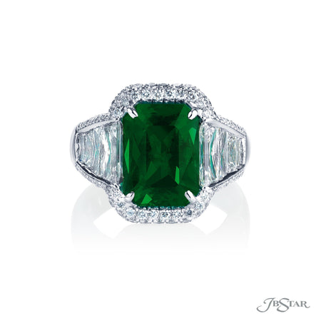 Dazzling emerald and diamond ring featuring a 3.58 ct. emerald-cut emerald center embraced by trapezoid diamonds in a micro pave setting. Handcrafted in pure platinum. [details] Center Stone(s) SHAPE TYPE WEIGHT Emerald Emerald 3.58 ct. Stone Information SHAPE TYPE WEIGHT Trapezoid Diamond 2.17 ctw. Round Diamond 0.75 ctw. [enddetails] | JB Star 7007-037 Precious Color Rings