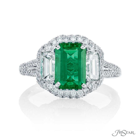 Gorgeous emerald and diamond ring featuring a 1.89 ct. emerald-cut emerald center embraced by two emerald-cut diamonds in a micro pave setting. Handcrafted in pure platinum. [details] Center Stone(s) SHAPE TYPE WEIGHT Emerald Emerald 1.89 ct. Stone Information SHAPE TYPE WEIGHT Emerald Round Diamond Diamond 1.11 ctw. 0.84 ctw. [enddetails] | JB Star 7043-003 Precious Color Rings