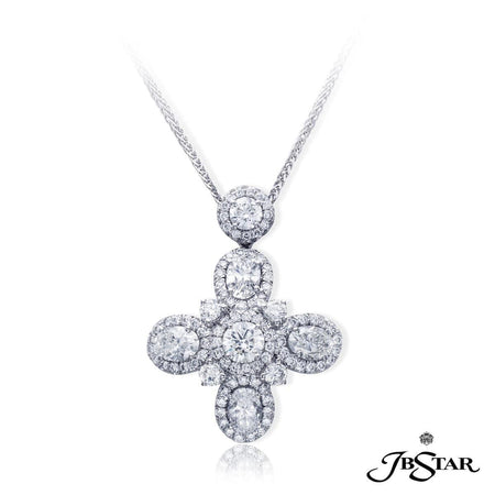 Diamond pendant handcrafted with 4 beautifully matched oval diamonds radiating from a center round diamond, each encircled in pave. [details] Stone Information SHAPE TYPE WEIGHT Oval Round Diamond Diamond 1.89 ctw. 1.71 ctw. [enddetails] | JB Star 7153-001 Pendants