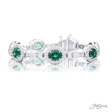 Gorgeous emerald and diamond bracelet featuring beautiful oval green emeralds in a micro pave setting connected by tapered baguette and round diamonds. Handcrafted in pure platinum. [details] Stone Information SHAPE TYPE WEIGHT Oval Emerald 7.26 ctw. Round Diamond 3.87 ctw. Tapered Baguette Diamond 1.50 ctw. [enddetails] | JB Star 7275-006 Bracelets