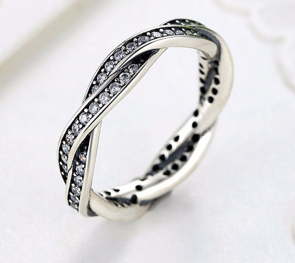 Sterling Silver Twist Of Fate Ring - CrumelsWorld
