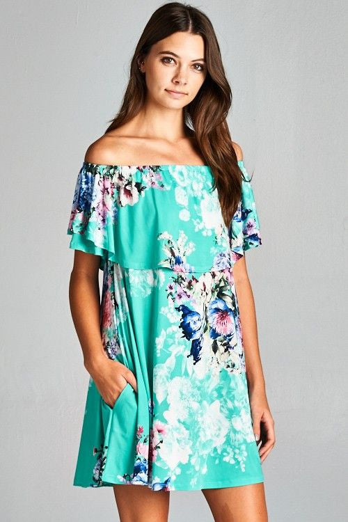 Floral poly spandex off shoulder dress with hidden pocket.