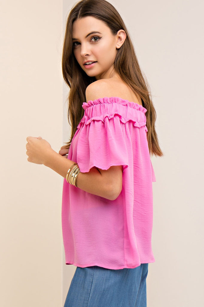 Solid crinkled off-shoulder top featuring elasticized neckline. Semi-sheer. Woven. Lightweight.