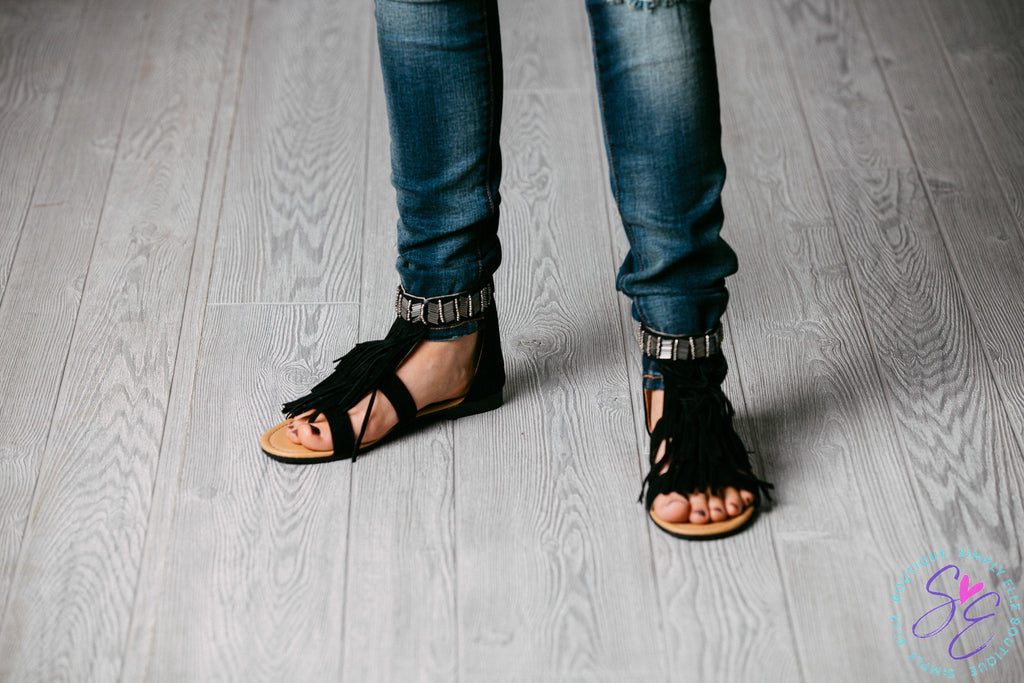 Black fringe sandal. Soft velvet material. Zipper back.