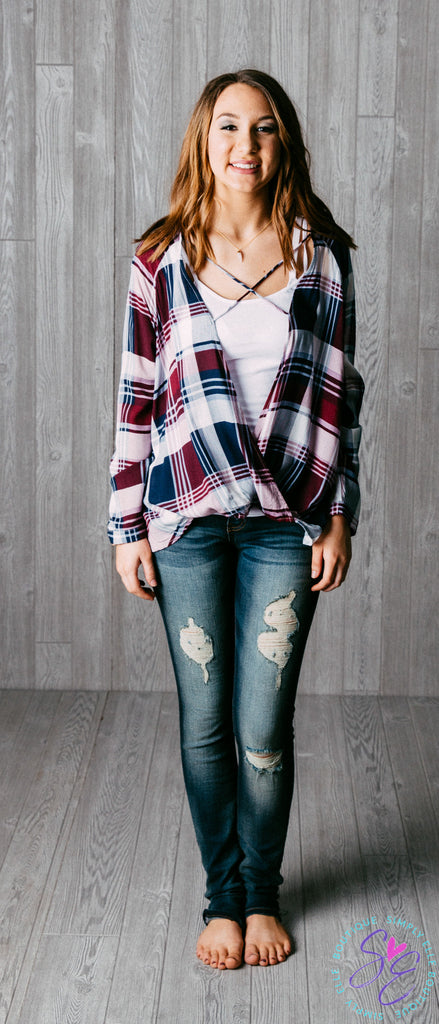Long sleeve plum plaid top. Criss cross front detail.