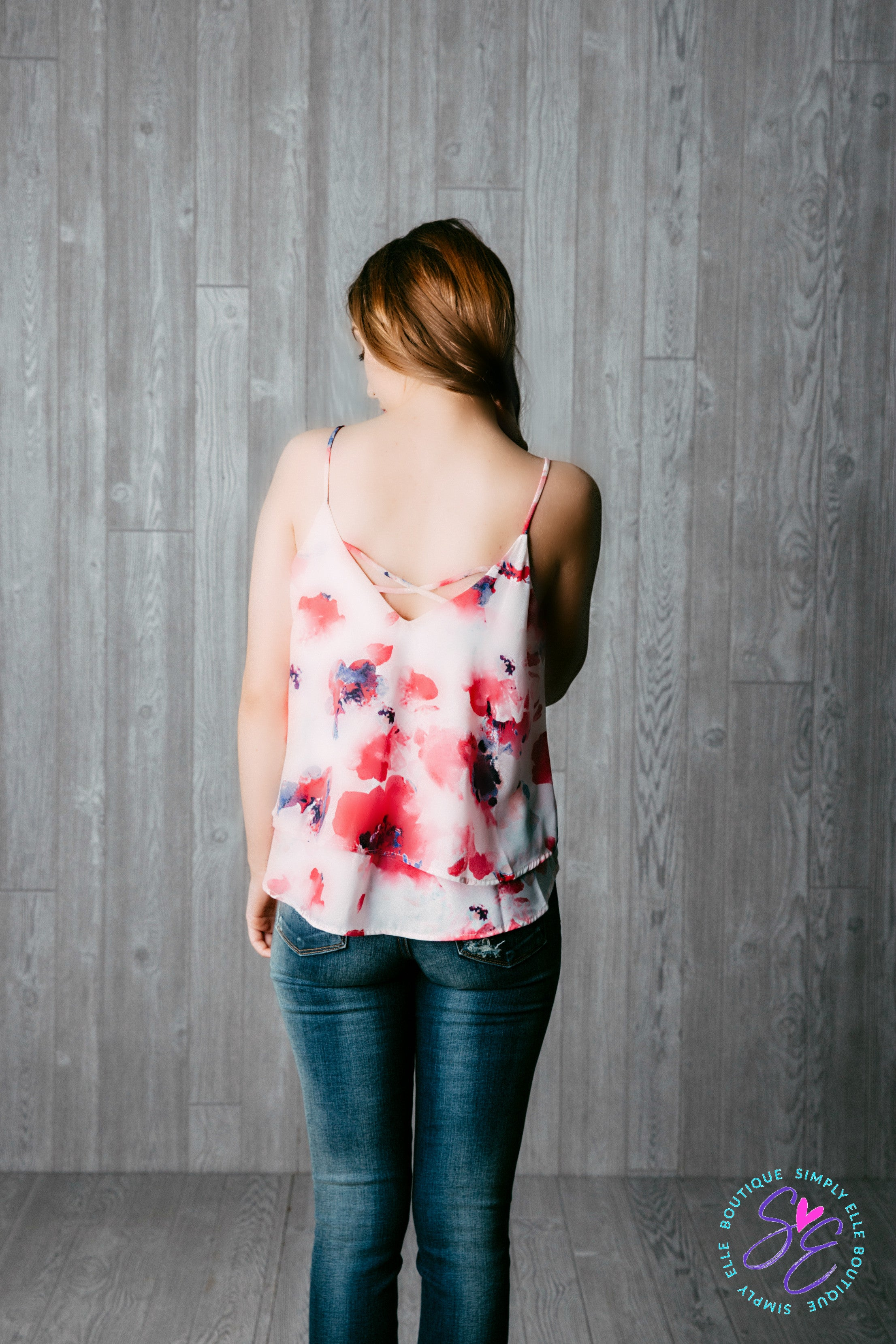 White and pink spaghetti strap tank top. Criss cross back.