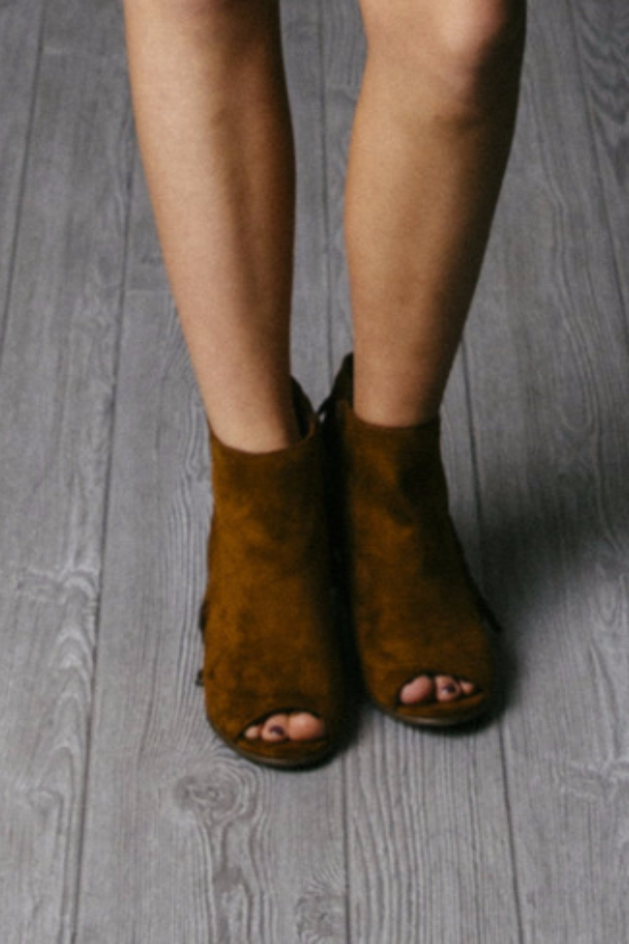 Tan peep toe faux suede material, open toe, side zipper.
