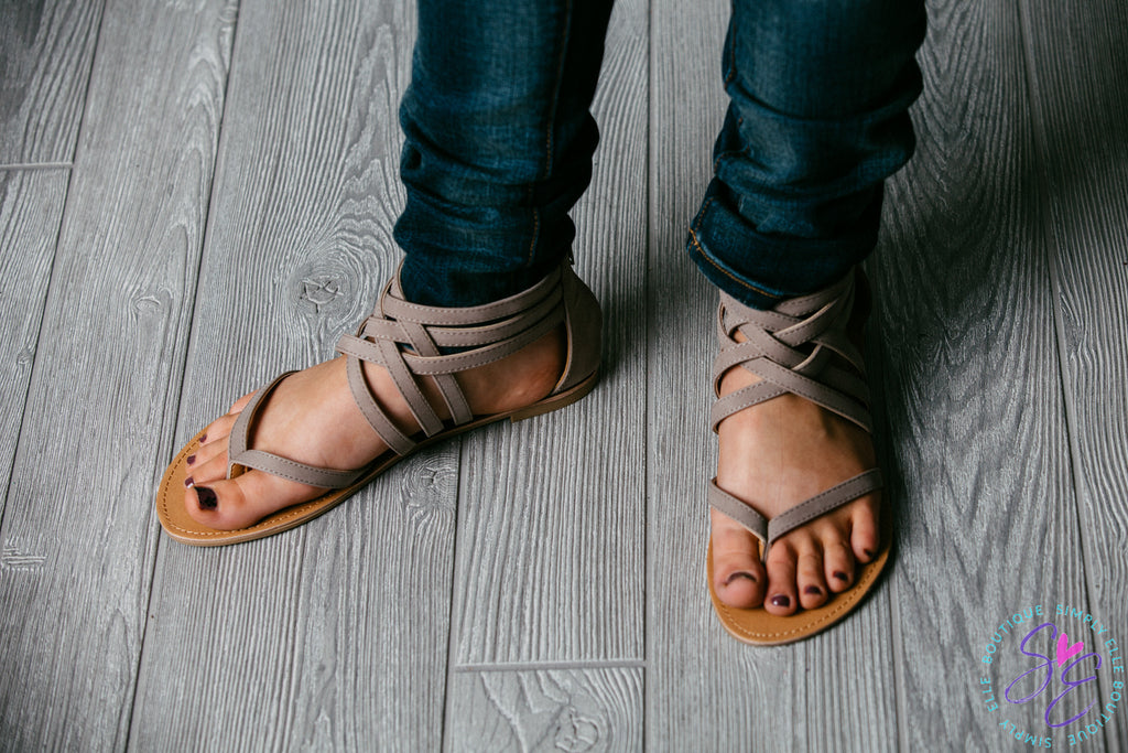Through the toe taupe sandal. Zipper at the ankle.